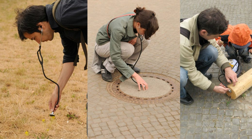 Three images next to one another. The first image on the left shows a young man bending down and listening to the grass with a stethoscope. The second image in the middle shows a young woman listening to a sewer cover with a stethoscope. The last image shows a man and a young child listening to a piece of wood on the ground with a stethoscope.